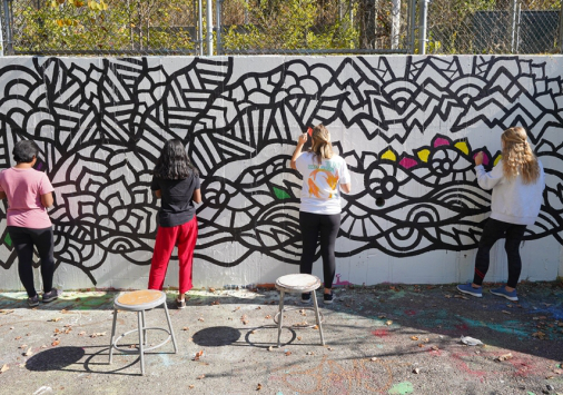 Students creating a mindful graffiti wall
